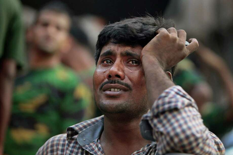 A Bangladeshi relative of a victim cries at the site of a building that collapsed Wednesday in Savar, near Dhaka, Bangladesh,Thursday, April 25, 2013. By Thursday, the death toll reached at least 194 people as rescuers continued to search for injured and missing, after a huge section of an eight-story building that housed several garment factories splintered into a pile of concrete. Photo: A.M. Ahad, AP / AP