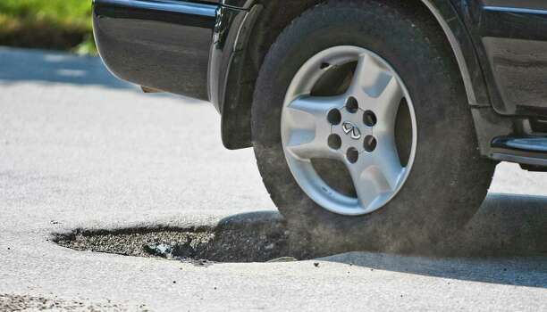 5. Potholes: You'll have a rude awakening if you expected smooth roads. Roads inside the Loop are littered with potholes, including some large enough to swallow a Mini.   Photo: Nick de la Torre/Chronicle