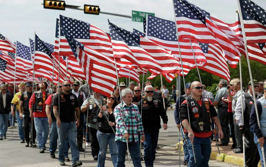 Members of the Patriot Guard line the road for  a procession prior to a memorial service for first responders who died in last week's fertilizer plant explosion in West, Texas, Thursday, April 25, 2013, in Waco, Texas.  President Barack Obama, U.S. Sen. John Cornyn and Texas Gov. Rick Perry are set to speak at Thursday's memorial at Baylor University's Ferrell Center in Waco. Firefighters and other first responders were among those killed when a fire at the plant erupted in an explosion last week. Hundreds of people were injured.  (AP Photo/Eric Gay) Photo: Eric Gay, Associated Press / AP