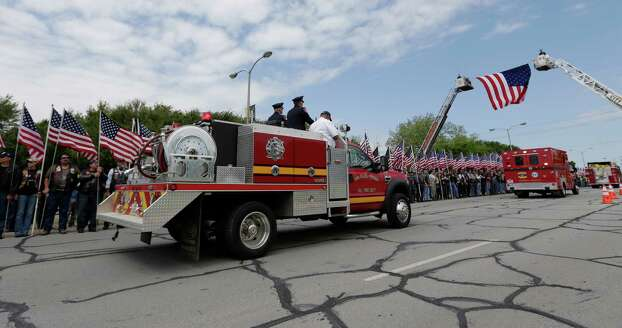 Fire trucks take part in a procession prior to a memorial service for first responders who died in last week's fertilizer plant explosion in West, Texas, Thursday, April 25, 2013, in Waco, Texas. President Barack Obama, U.S. Sen. John Cornyn and Texas Gov. Rick Perry are set to speak at Thursday's memorial at Baylor University's Ferrell Center in Waco. Firefighters and other first responders were among those killed when a fire at the plant erupted in an explosion last week. Hundreds of people were injured. (AP Photo/Eric Gay) Photo: Eric Gay, Associated Press / AP