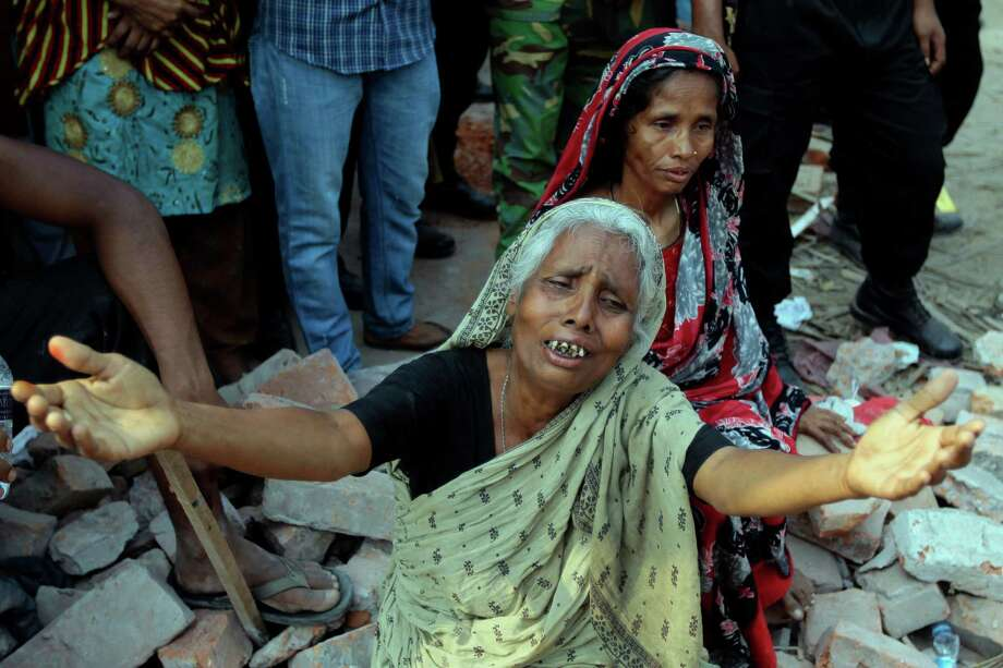 A Bangladeshi woman relative of a victim cries at the site of a building that collapsed Wednesday in Savar, near Dhaka, Bangladesh, Thursday, April 25, 2013. By Thursday, the death toll reached at least 194 people as rescuers continued to search for injured and missing, after a huge section of an eight-story building that housed several garment factories splintered into a pile of concrete. Photo: A.M. Ahad, AP / AP