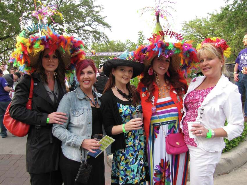 These attendees pose early on at A Taste of the Northside on Wednesday at The Club at Sonterra. The Fiesta event raises funds for The Brighton Center.