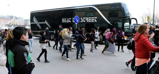 FILE - This Tuesday April 23, 2013, photo from files shows young girls running towards pop singer Justin Bieber's tour bus as it parks outside Grand Hotel where Bieber were staying during his concerts in Stockholm, Sweden. Swedish police said on Thursday they found drugs on Bieber's tour bus in Stockholm, but had no suspects and were unlikely to pursue the case further. (AP Photo/Scanpix Sweden, Leo Sellen, File)   SWEDEN OUT Photo: Leo Sellen