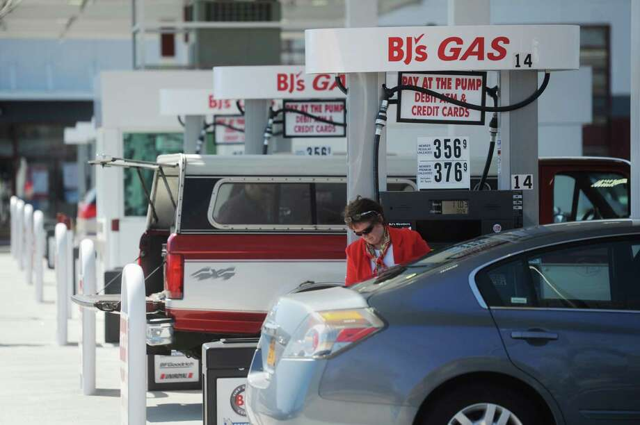 Nancy Hutchinson, of Brookfield, fills up at the gas station at BJ's Wholesale Club on Federal Road in Brookfield, Conn. on Thursday, April 25, 2013.  BJ's, which has been open since December, recently opened a gas station for club members. Photo: Tyler Sizemore / The News-Times