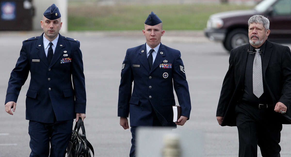 U.S. Air Force Staff Sergeant Robert Hudson (center) walks at Joint Base San Antonio-Lackland Thursday April 25, 2013. The training instructor is accused of having sex with a technical school trainee and other charges.