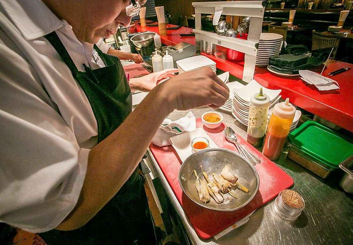 Chef Alex Ong prepares the Tempura Mushrooms at Hutong in San Francisco, Calif. on Thursday, April 18th, 2013.