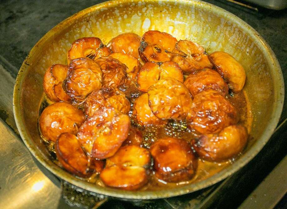 Apples being caramelized for the duck breast entree.
