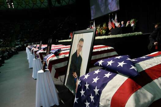 Caskets and pictures of firefighters are displayed during a memorial service at Baylor University in Waco, Texas, on April 25, 2013 for the firefighters who were killed in a huge blast at a Texas fertilizer plant last week. Around 200 people were injured in the April 17 blast in West, a small town of 2,800 people located 80 miles (130 kilometers) south of Dallas. AFP PHOTO/Jewel SamadJEWEL SAMAD/AFP/Getty Images Photo: JEWEL SAMAD, AFP/Getty Images / AFP
