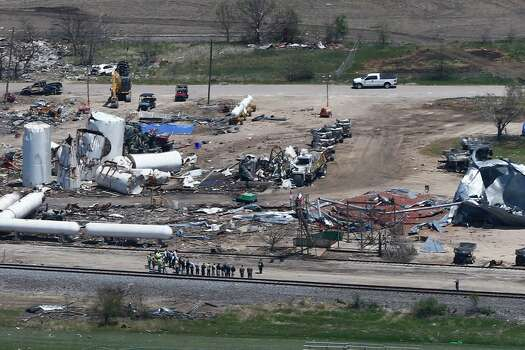 Damage from the West, Texas, fertilizer plant explosion is seen from helicopters as President Barack Obama travels to a memorial in Waco, Texas, Thursday, April 25, 2013. (AP Photo/Charles Dharapak) Photo: Charles Dharapak, Associated Press / AP