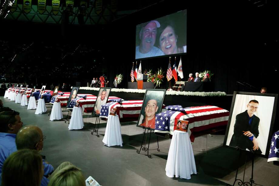 Casket sit in front of the stage of a memorial for firefighters who were killed in the West, Texas, fertilizer plant explosion prior to President Barack Obama's arrival, Thursday, April 25, 2013, at Baylor University in Waco,Texas. (AP Photo/Charles Dharapak) Photo: Charles Dharapak, Associated Press / AP
