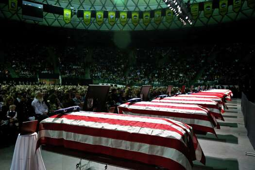Caskets sit in front of the stage of a memorial for firefighters who were killed in the West, Texas, fertilizer plant explosion before President Barack Obama arrives, Thursday, April 25, 2013, at Baylor University in Waco,Texas. (AP Photo/Charles Dharapak) Photo: Charles Dharapak, Associated Press / AP