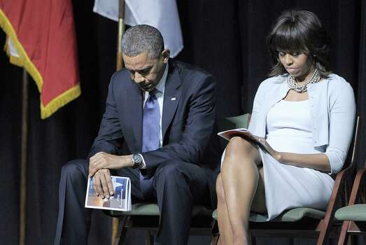 US President Barack Obama and First Lady Michelle Obama attend the memorial service at Baylor University in Waco, Texas, on April 25, 2013 for 14 people killed in the explosion of a fertilizer plant in West, Texas. Around 200 people were injured in the April 17 blast in West, a small town of 2,800 people located 80 miles (130 kilometers) south of Dallas. AFP PHOTO/Jewel SamadJEWEL SAMAD/AFP/Getty Images Photo: JEWEL SAMAD, AFP/Getty Images / AFP