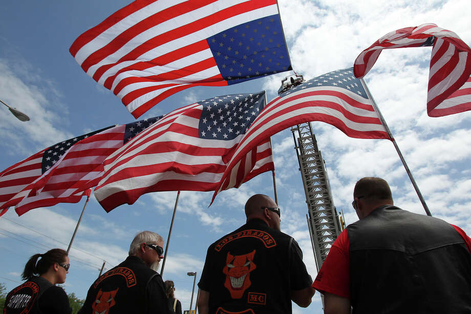 Patriot Guard Riders stand at attention as firefighters congregate at Baylor University for memorial services for their fallen comrades in West  on  April 25 2013. Photo: TOM REEL