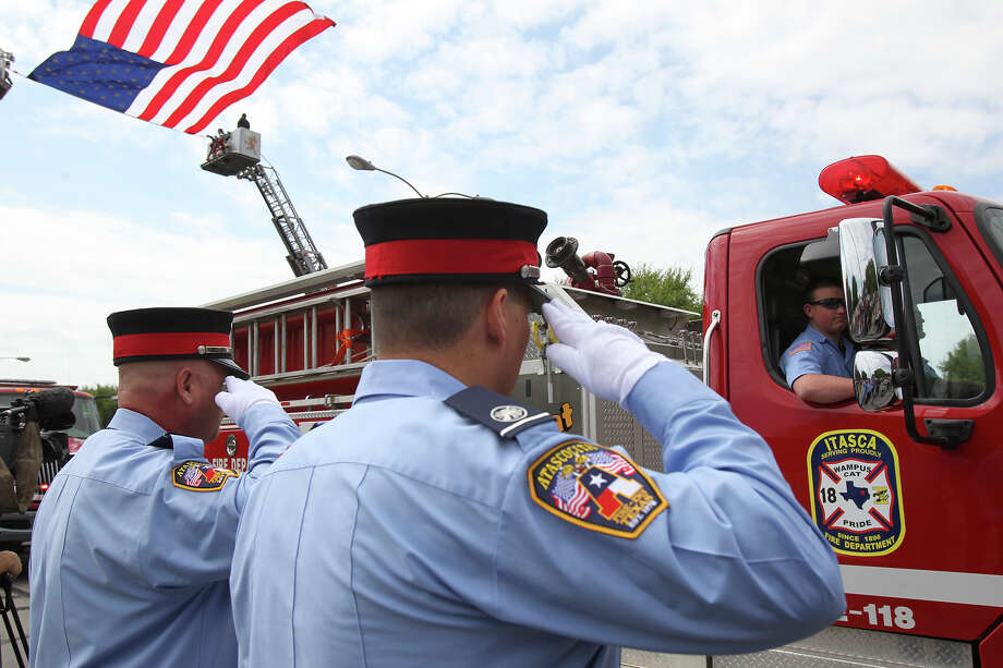 The procession begins as firefighters congregate at Baylor University for memorial services for their fallen comrades in West  on  April 25 2013. Photo: TOM REEL
