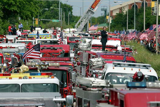 Firefighters congregate at Baylor University for memorial services for their fallen comrades in West  on  April 25 2013. Photo: TOM REEL