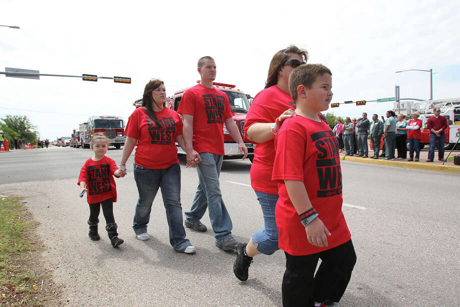 A family walks together toward the entrances as fFirefighters congregate at Baylor University for memorial services for their fallen comrades in West  on  April 25 2013. Photo: TOM REEL