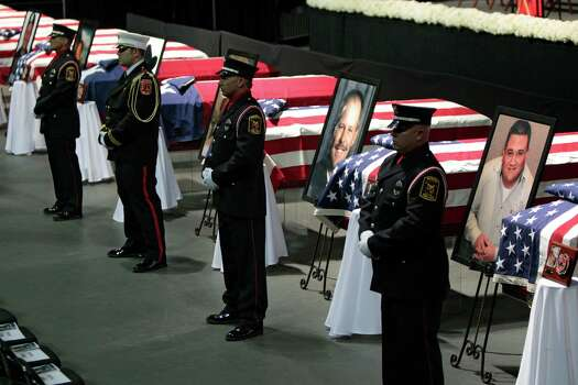 WACO, TX - APRIL 25:  An honor guards stand next to caskets at the West Memorial Service on April 25, 2013 in Waco, Texas. The memorial service honored the volunteer firefighters that lost their lives at the fertilizer plant explosion in West, Texas last week. Photo: Erich Schlegel, Getty Images / 2013 Getty Images
