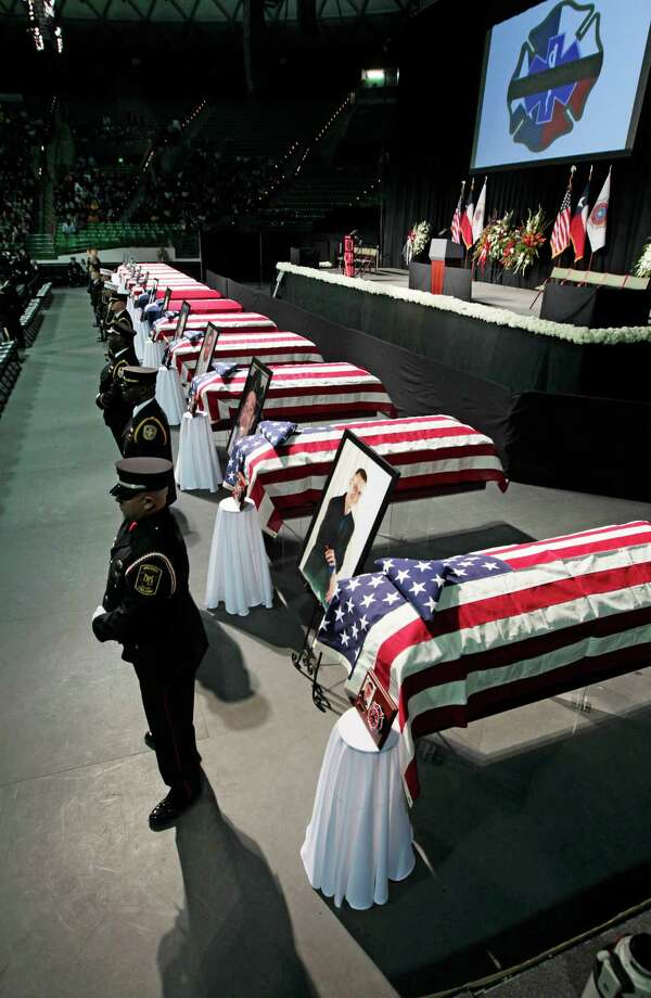 WACO, TX - APRIL 25:  An honor guards stand next to twelve caskets at the West Memorial Service on April 25, 2013 in Waco, Texas. The memorial service honored the volunteer firefighters that lost their lives at the fertilizer plant explosion in West, Texas last week. Photo: Erich Schlegel, Getty Images / 2013 Getty Images