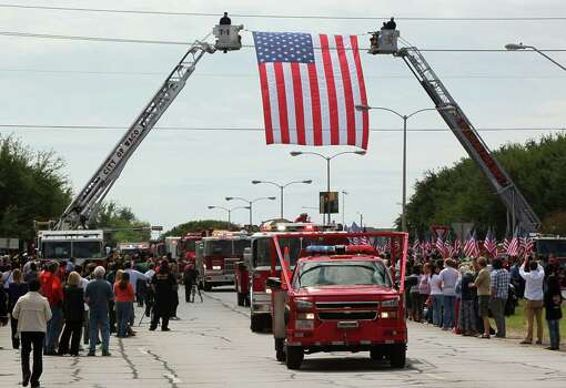 WACO, TX - APRIL 25: Fire departments from around Texas pay their respects as they parade in to the West Memorial Service on April 25, 2013 in Waco, Texas. The memorial service honored the volunteer firefighters that lost their lives at the fertilizer plant explosion in West, Texas last week. Photo: Erich Schlegel, Getty Images / 2013 Getty Images