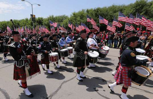 Bagpipers from across the country march in  a procession  to a memorial service for first responders who died in last week's fertilizer plant explosion in West, Texas, Thursday, April 25, 2013, in Waco, Texas.  President Barack Obama, U.S. Sen. John Cornyn and Texas Gov. Rick Perry are set to speak at Thursday's memorial at Baylor University's Ferrell Center in Waco. (AP Photo/Waco Tribune Herald, Rod Aydelotte) Photo: Rod Aydelotte, Associated Press / The Waco Tribune-Herald