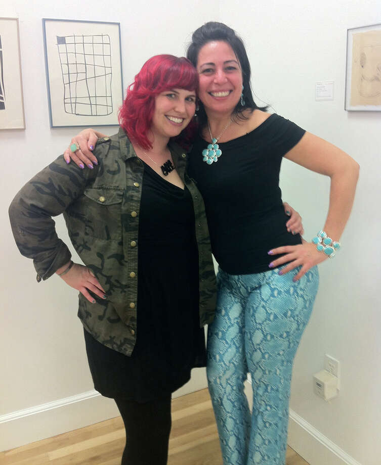 "Raquel Cueto, 49, of Norwalk, and Holly Danger, 33, of Stamford, showed off their threads at the opening of ""Be(come) a Collector"" at Fernando Luis Alvarez Gallery in Stamford last week. Cueto wore Vertigo-made, faux snakeskin pants in cornflower blue and a bandage-style black top. Danger wore a camouflage jacket designed by Staring at Stars over a simple black dress with a low-cut neck and a necklace by Plastique. Photo: Scott Gargan"