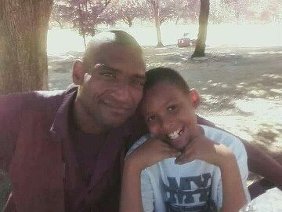 David Thomas is seen with his son, Davon, in this undated photo. Thomas died in a BART station elevator shaft, where he had been living. Photo: Valerie Blackmore, Courtesy