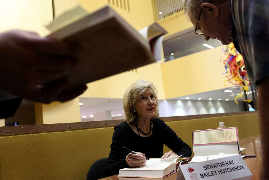 "Former U.S. Sen. Kay Bailey Hutchison signs her book about Texas women and their ""spirit of survival and perseverance."" Photo: Lisa Krantz, San Antonio Express-News"