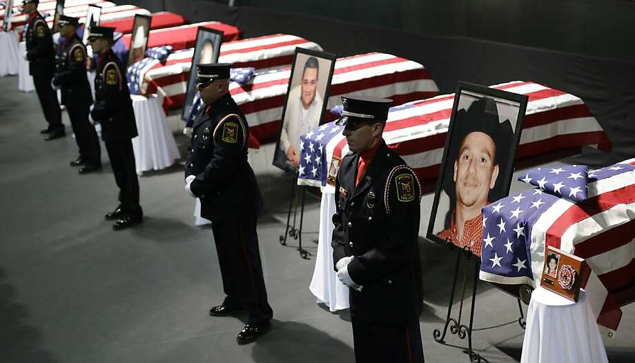 An honor guard stands in front of flag-draped caskets before a memorial service at Baylor University for first responders who died in last week's fertilizer plant explosion in West, Texas. Photo: Eric Gay, Associated Press