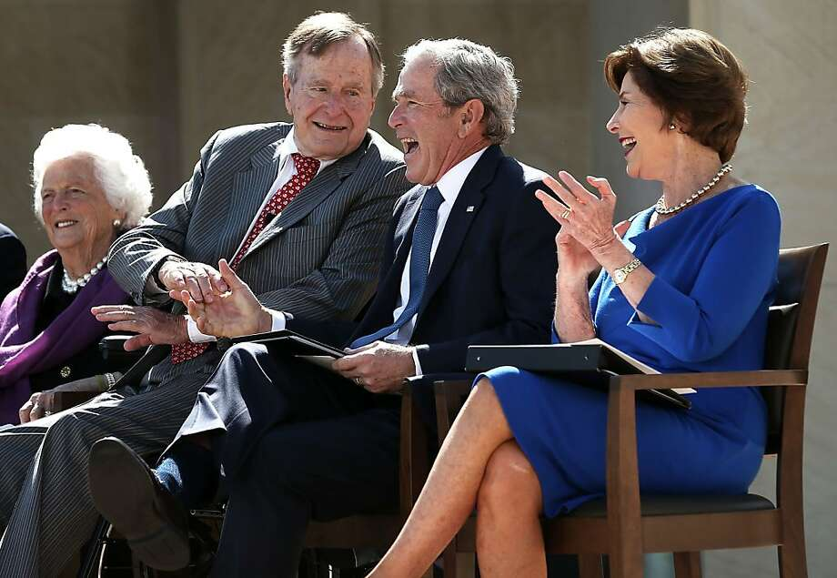 DALLAS, TX - APRIL 25:  Former U.S. President George W. Bush (2nd R) shakes hands with his father former President George H.W. Bush (2nd L) as they attend the opening ceremony of the George W. Bush Presidential Center with his wife, former first lady Laura Bush (R), and his mother, former first lady Barbara Bush (L), April 25, 2013 in Dallas, Texas. The Bush library, which is located on the campus of Southern Methodist University, with more than 70 million pages of paper records, 43,000 artifacts, 200 million emails and four million digital photographs, will be opened to the public on May 1, 2013. The library is the 13th presidential library in the National Archives and Records Administration system.  Photo: Alex Wong, Getty Images