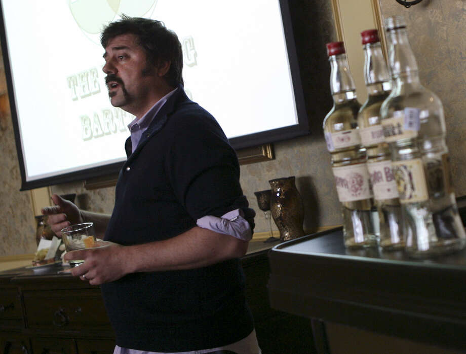 Author and bar owner Jason Kosmas presents his seminar on mixology flavor and profile at Bohanan's Bar. He is the co-founder of the 86 Company, which recently released a line of spirits, including Fords Gin, Cabeza Tequila and Caña Brava Rum. Photo: Photos By Cynthia Esparza / For The Express-News