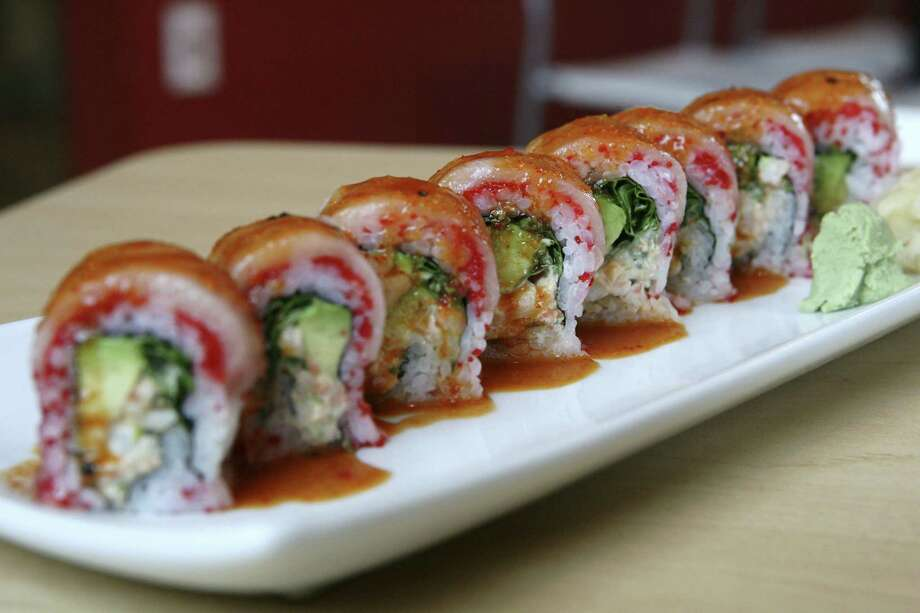 The yellowfish roll features picante shrimp, avocado and cilantro on the inside with fresh yellowtail and habanero-infused caviar on the outside, with a drizzle of mild salsa on top. Photo: Photos By Cynthia Esparza / For The Express-News