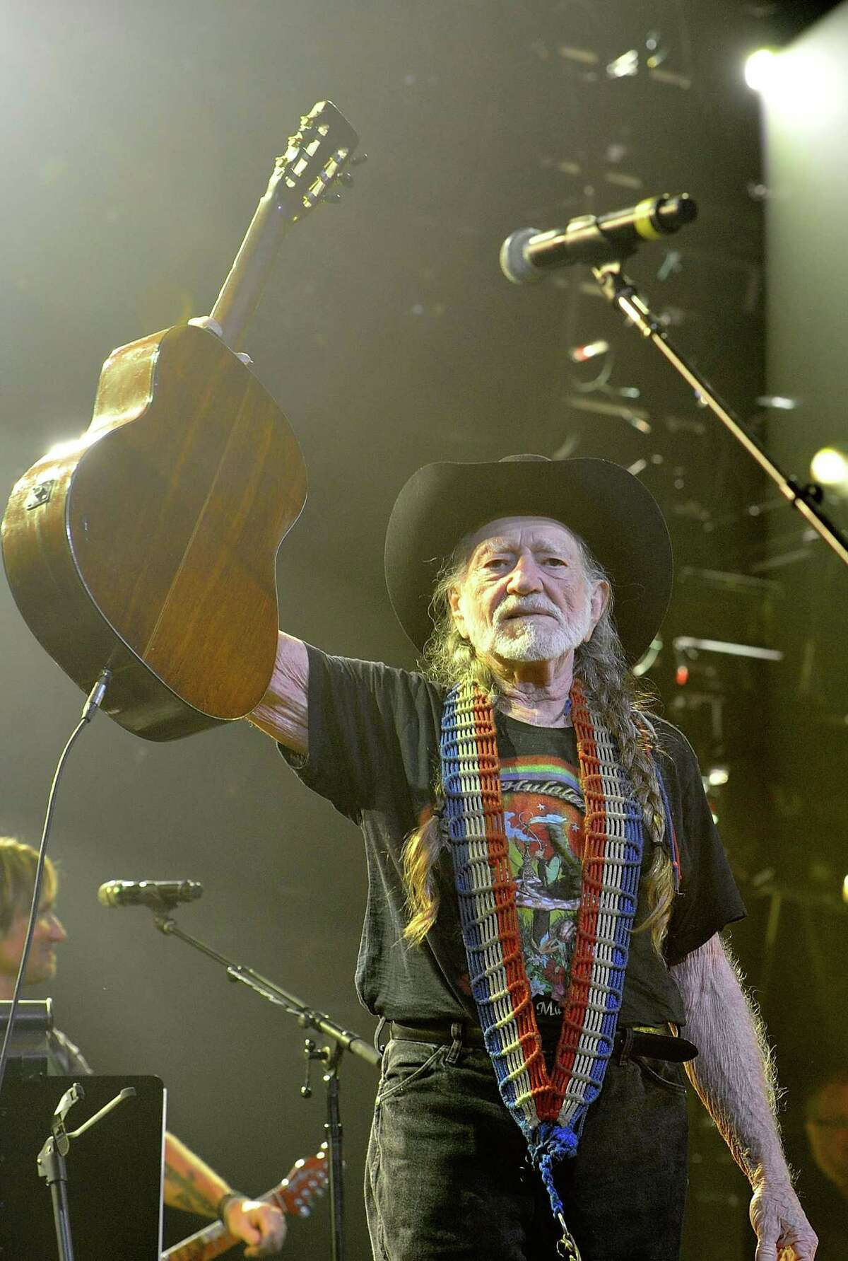 NASHVILLE, TN - APRIL 16: Willie Nelson performs during Keith Urban's Fourth annual We're All For The Hall benefit concert at Bridgestone Arena on April 16, 2013 in Nashville, Tennessee.
