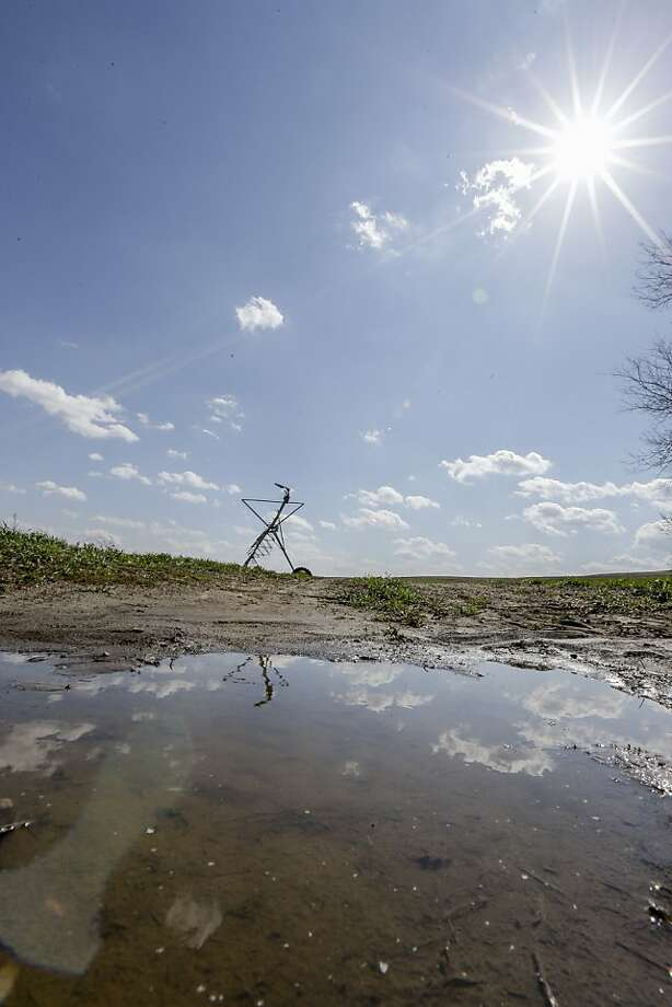 Rain that eased the Midwest's drought is creating trouble for farmers who can't plant on muddy land. Photo: Nati Harnik, Associated Press