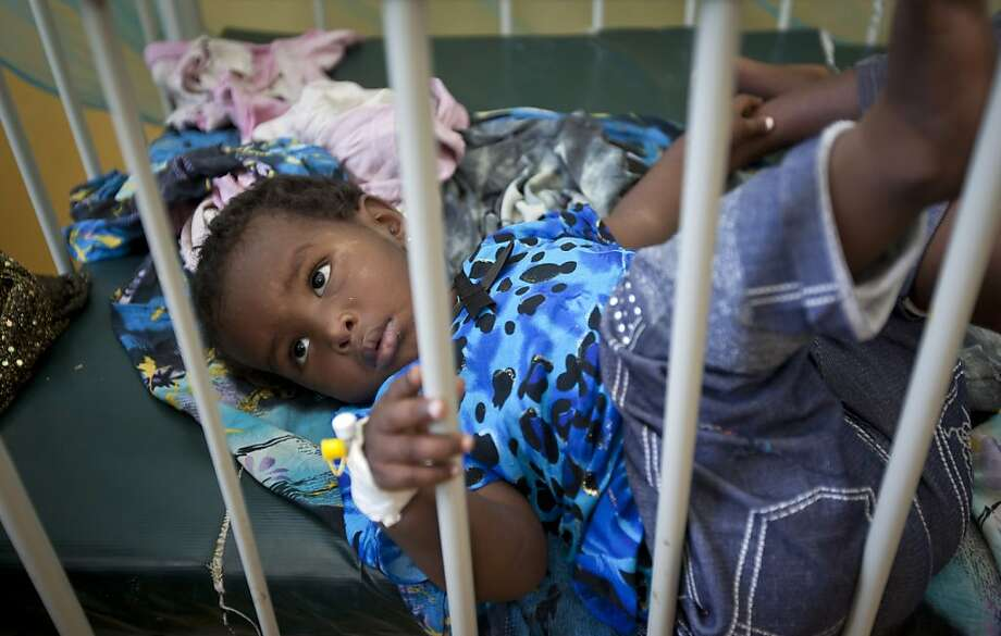 A Somali child with measles lies in a bed in an isolation ward of the Benadir hospital in Mogadishu, Somalia Wednesday, April 24, 2013. On the eve of the Global Vaccine Summit in Abu Dhabi and coinciding with World Immunization Week, the authorities in Somalia, which has one of the lowest immunization rates in the world, have launched a new push to vaccinate against several potentially fatal childhood diseases. (AP Photo/Ben Curtis) Photo: Ben Curtis, Associated Press