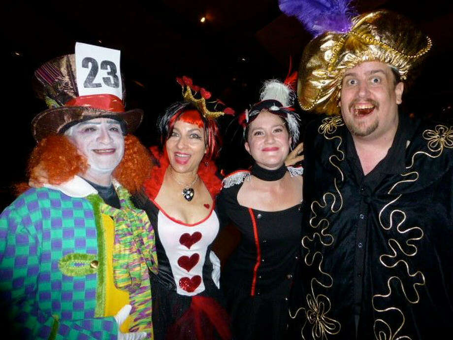 "Mad Hatter David Frausto (from left), pauses on the dance floor with Queen of Hearts Jessica Saucedo, Christina Alvarado and ""hypnotist"" John Vilandre at the Urban-15 Group's Incognito Masked Ball."