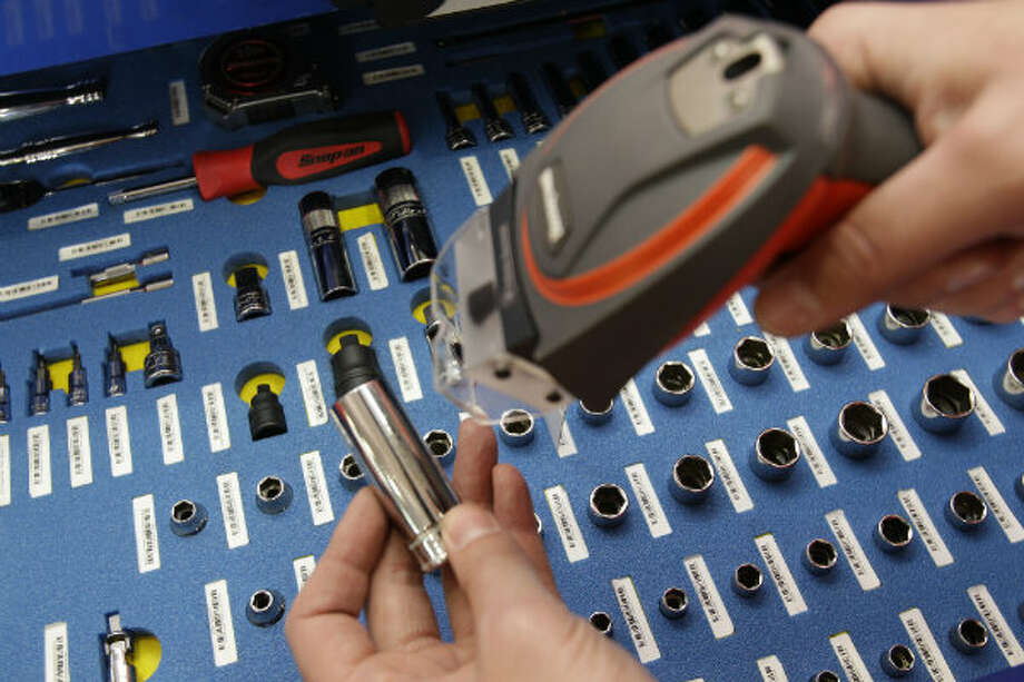 Barcoded tool items are scanned in and out of service through the wireless network tool control shown inside the Snap-on mobile advance technology lab during a demonstration at NOV Wilson Distribution Center, 12000 West Little York Road, Thursday, April 25, 2013, in Houston. Snap-on Industrial is making a major push into the oil and natural gas markets by introducing several new tools and equipment to these industries. Snap-on is launching these new tools in a national tour. NOV Wilson is a large distributor of products aimed at the maintenance activities for the oil, drilling and natural gas industries.