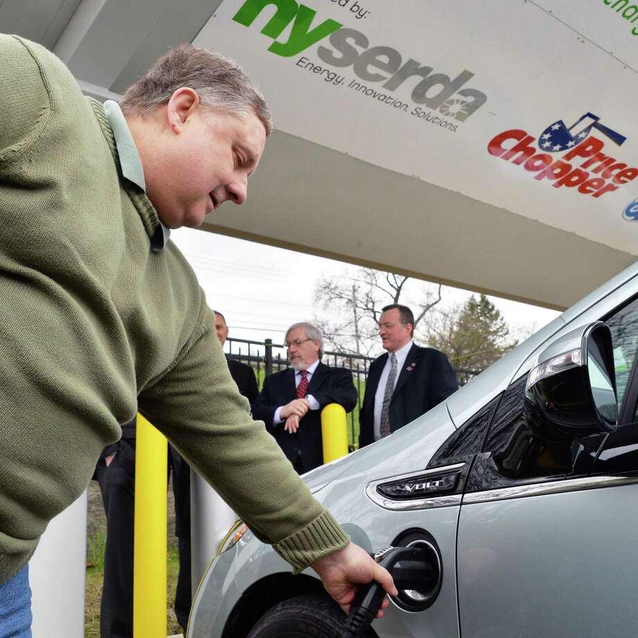 Rick Lipinskas of Guilderland plugs his Chevy Volt into at the new electric vehicle charging stations at the Price Chopper store on Balltown Road in Mohawk Commons in Niskayuna, NY Thursday April 25, 2013.  (John Carl D'Annibale / Times Union) Photo: John Carl D'Annibale / 10022117A