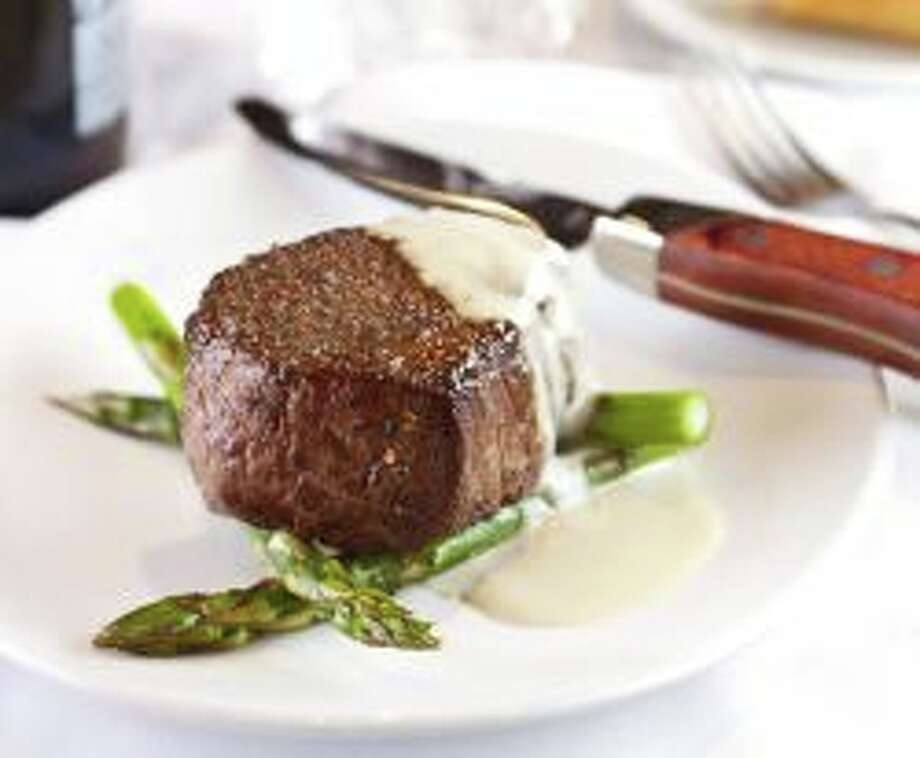 Fleming's: Porcini Rubbed Filet Mignon with grilled asparagus spears and gorgonzola cream sauce