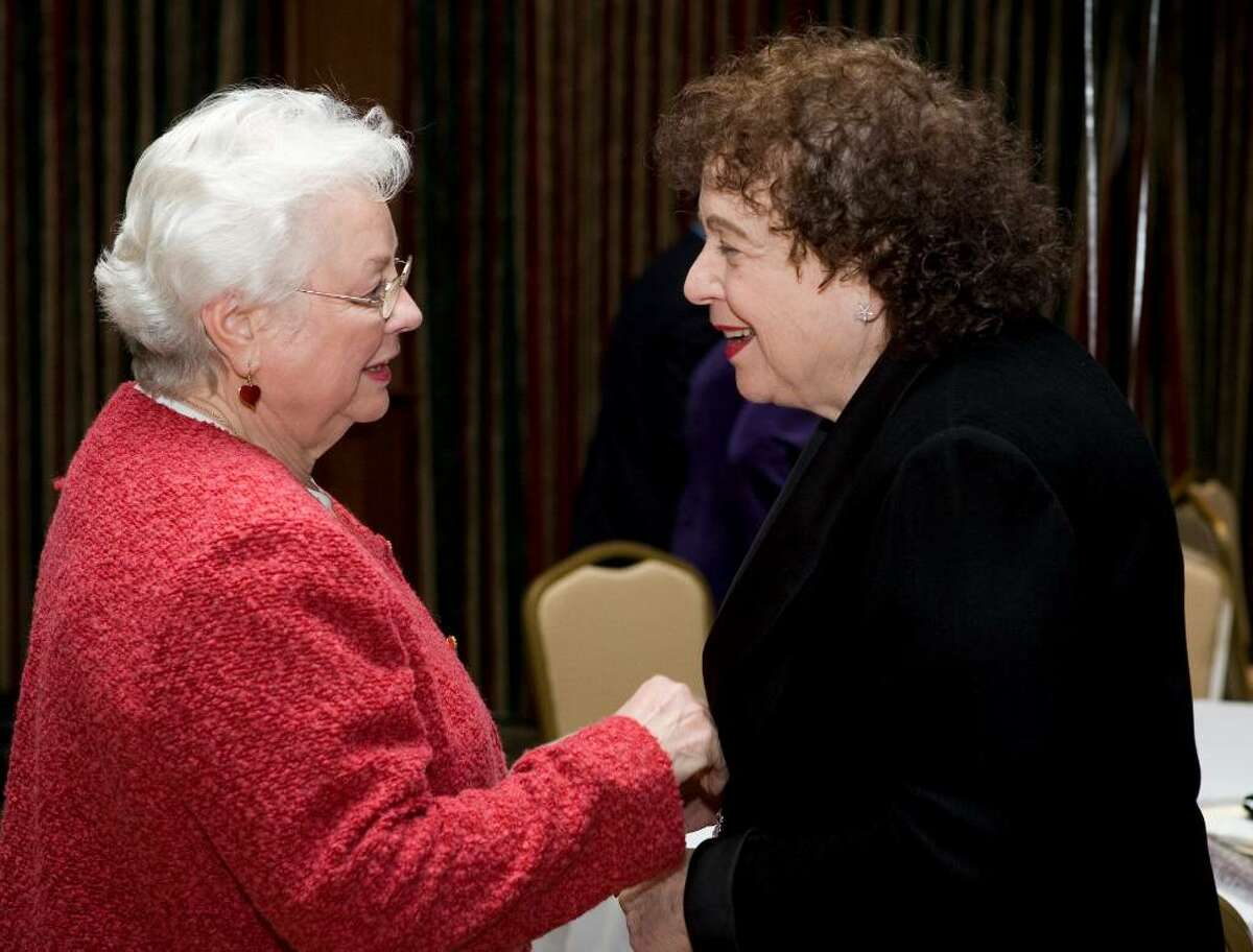 Stamford Senior Center outgoing director Jeanne Franklin, right, talks with former state representative Crystal Truglia, left, during a fundraiser in Franklin's honor at the Italian Center.