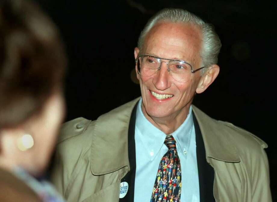 Former New Canaan First Selectman Dick Bond talks with voters outside of New Canaan High School, Nov. 4th, 1997. Photo: File Photo / Stamford Advocate File Photo