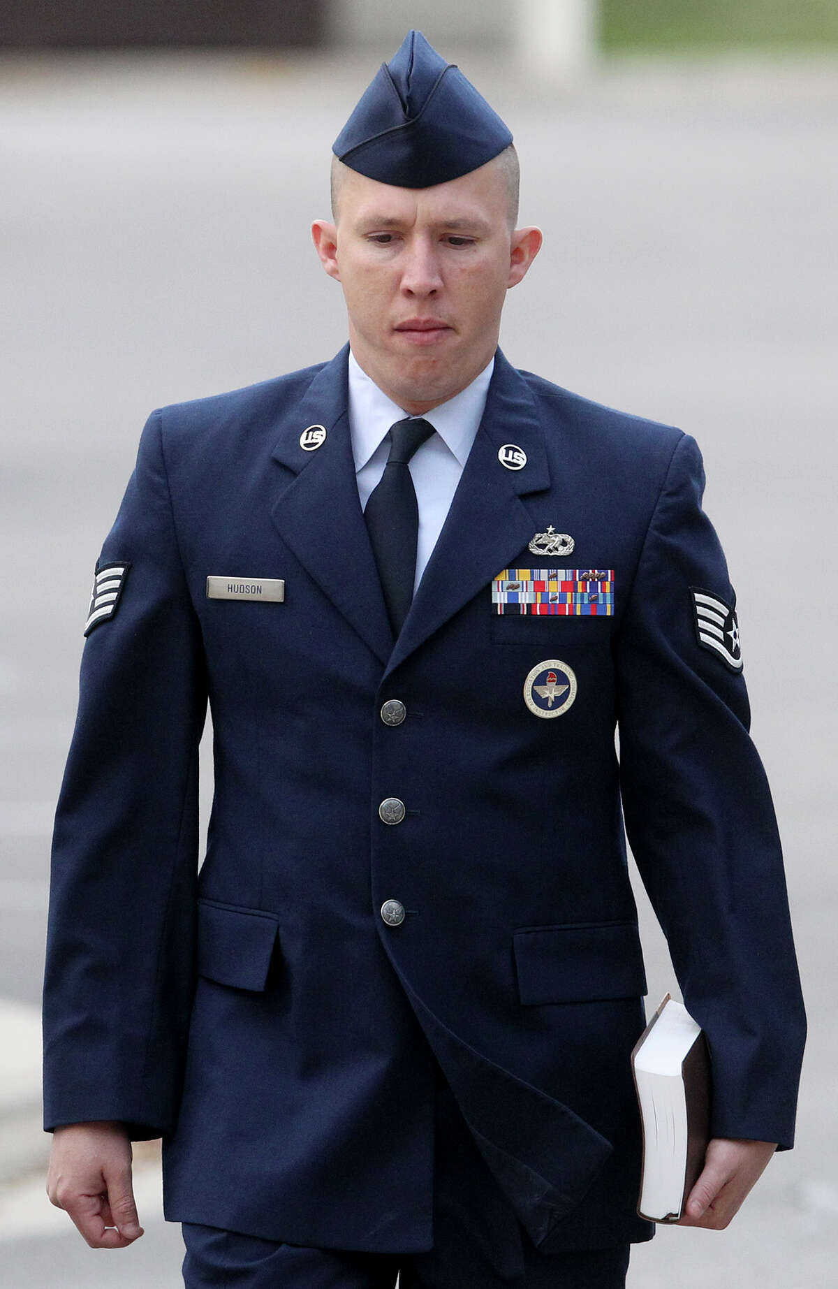 U.S. Air Force Staff Sergeant Robert Hudson walks at Joint Base San Antonio-Lackland Thursday April 25, 2013. The training instructor is accused of having sex with a technical school trainee and other charges.