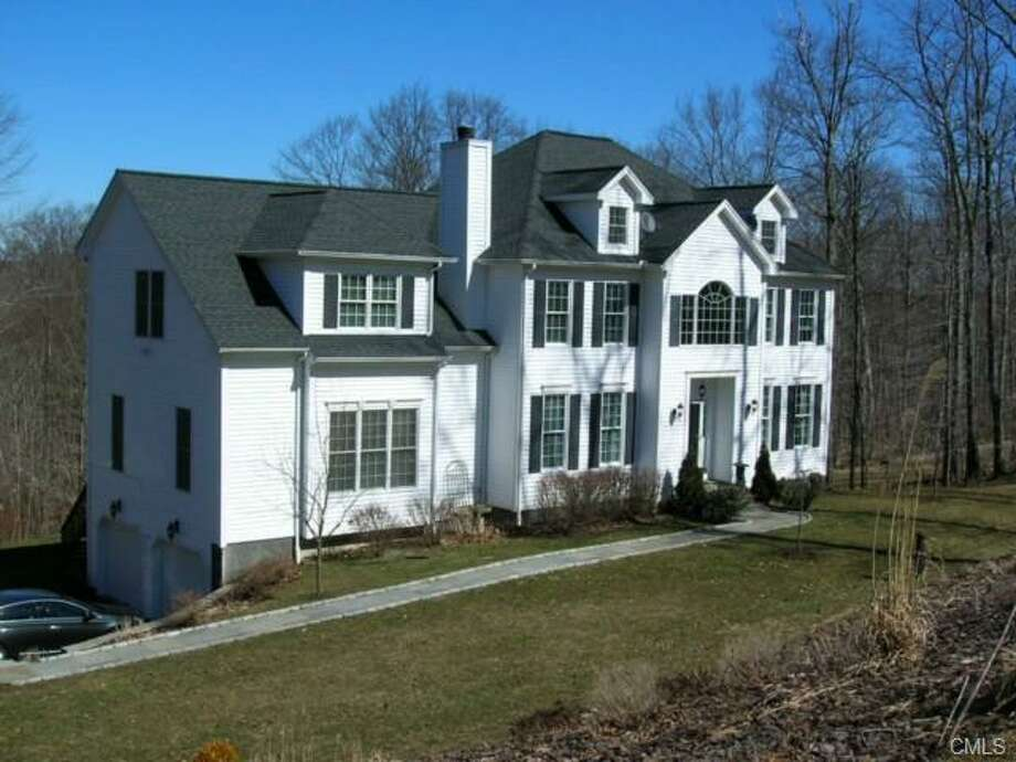 Go North, young man. If you make it all the way to New Milford, where the median value of an owner-occupied home is $336,000, you'll be able to find lots of elbow room in homes like this 3,629-square foot, four-bedroom house, which is listed at $499,000.