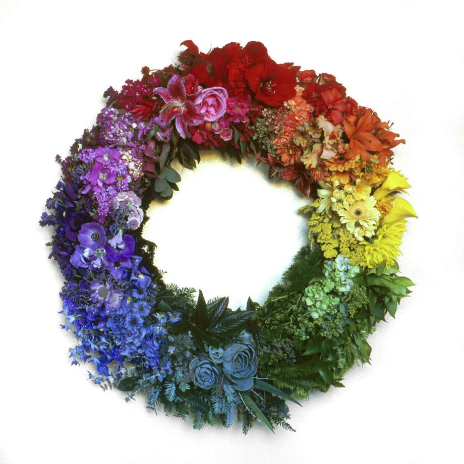 Jeni Webber's floral wreath resembles a color wheel. Photo: Lee Anne White / Associated Press