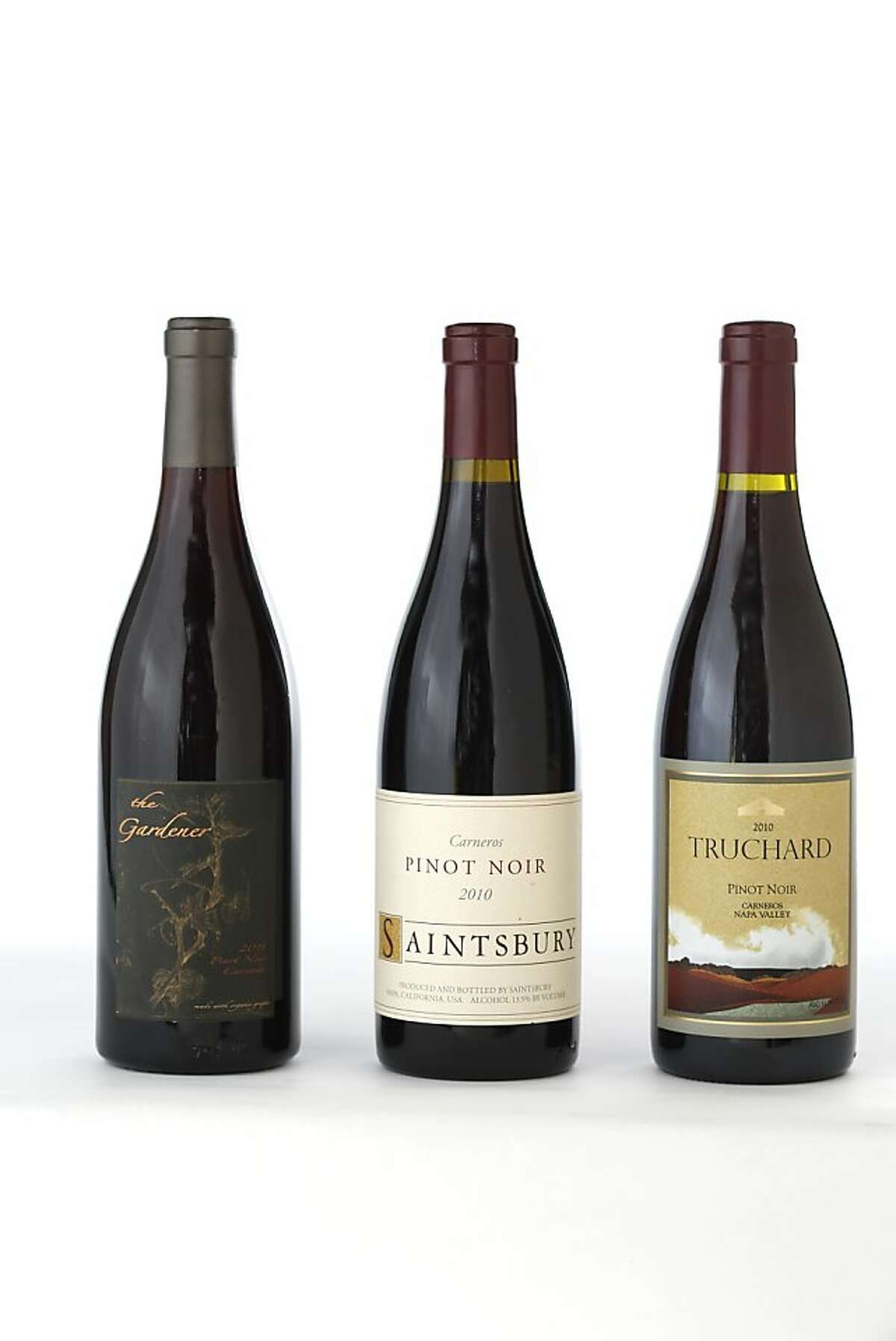 Three bottles of Carneros Pinot Noir left-right: 2011 The Gardner, 2010 Saintsbury, 2010 Truchard.