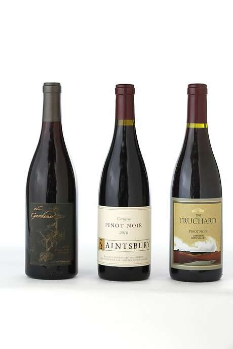 Three bottles of Carneros Pinot Noir left-right: 2011 The Gardner, 2010 Saintsbury, 2010 Truchard. Photo: Craig Lee, Special To The Chronicle