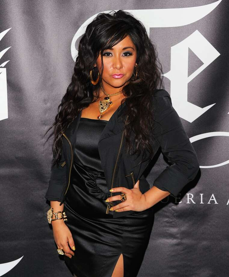 "BEFORE: Nicole ""Snooki"" Polizzi attends the grand opening of TEQA on February 24, 2011 in New York City.  (Photo by Andrew H. Walker/WireImage for TEQA)"