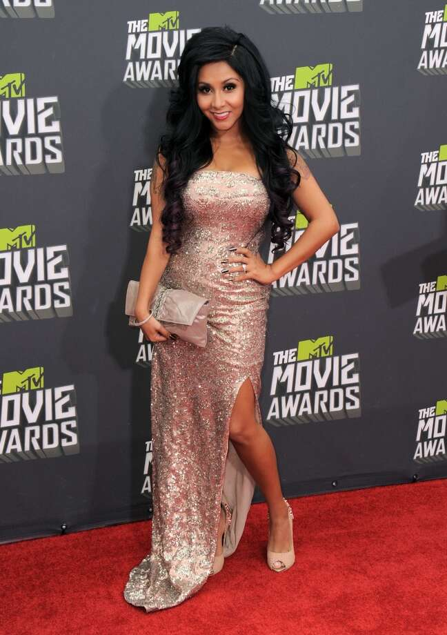 "AFTER the slim-down: Nicole ""Snooki"" Polizzi arrives at the MTV Movie Awards in Sony Pictures Studio Lot in Culver City, Calif., on Sunday April 14, 2013. (Photo by Jordan Strauss/Invision/AP)"