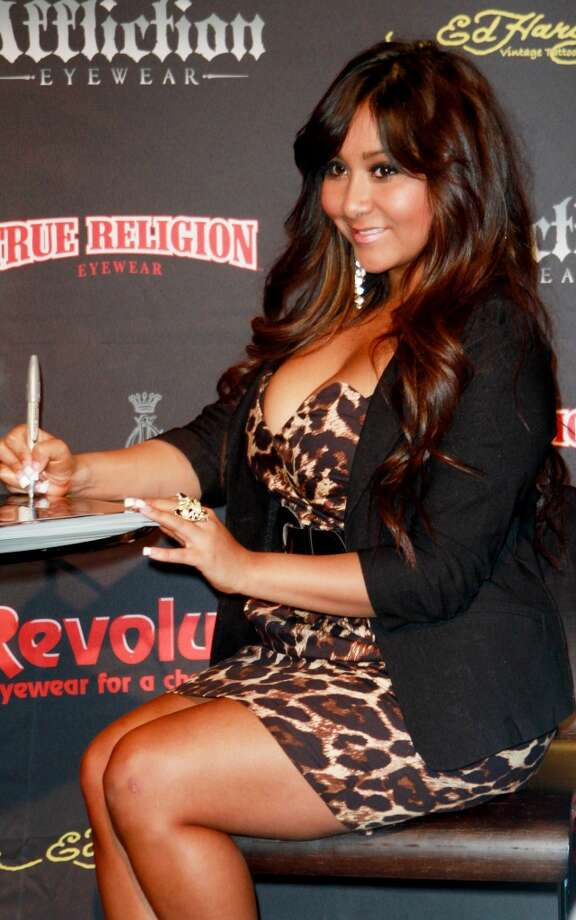 "BEFORE: TV Personality Nicole ""Snooki"" Polizzi visits the Revolution Eyewear booth at the 2011 International Vision Expo at the Javit's Convention Center on March 20, 2011 in New York City.  (Photo by Marcel Thomas/FilmMagic)"