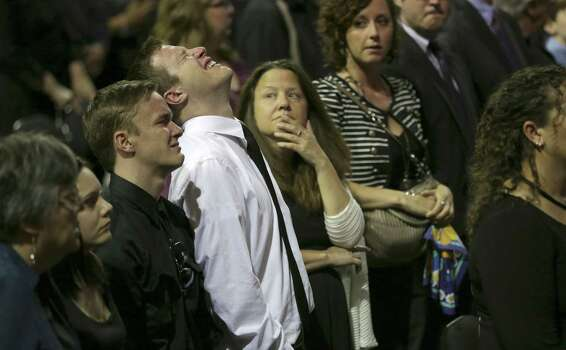 Family members of the fallen firefighter are overcome with grief, during the memorial service on Thursday April 25, 2013 at the Ferrell Center at Baylor University. Photo: Bob Owen, San Antonio Express-News / ©2013 San Antonio Express-News