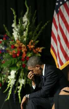 President Barack Obama bows in prayer on Thursday April 25, 2013, at the memorial service for the 12 first responders that were killed in the West explosion, at the Ferrell Center at Baylor University. Photo: Bob Owen, San Antonio Express-News / ©2013 San Antonio Express-News